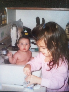 Natasha at the counter while Mikayla is in the sink.