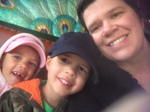Riding on the carousel at the zoo.
