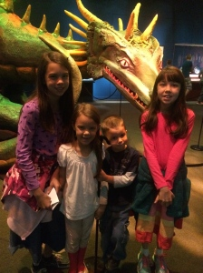 Posing with a mythical creature exhibit.