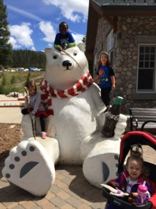 Kids by the giant Coca-Cola bear.