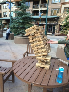 Jonathan's move in the giant Jenga game made the tower tumble! He thought he was in trouble!