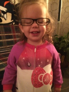 Katherine wearing mommy's reading glasses.