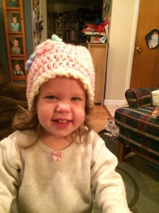 Katherine wearing a hat that Grandma Joanne made for her.
