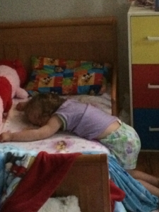 Katherine SLEEPING while being half way out of her bed!  Sound asleep!  June 2016